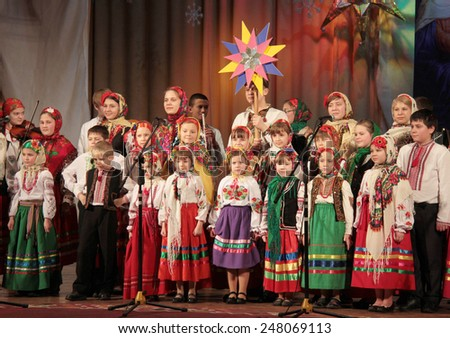 LUTSK, UKRAINE- JANUARY 23: Children choir performs in the theater at a charity concert to raise funds for orphans on January 23, 2015 in Lutsk, Ukraine.  - stock photo