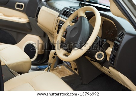 Luxe beige car passenger compartment - stock photo