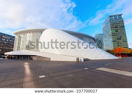 LUXEMBOURG, LUXEMBOURG - NOVEMBER 04, 2015: Philharmonie Luxembourg on Kirchberg plateau, opened in 2005, now plays host to 400 performances each year and is one of the main concert halls in Europe - stock photo