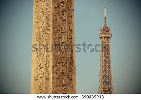 Luxor Egyptian Obelisk with Eiffel Tower at the center of Place de la Concorde - stock photo