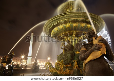 Luxor obelisk and Fontaine des Mers at the Place de la Concorde in the evening. - stock photo