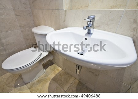 Luxurious bathroom detail with a classy wash basin and stone tiled walls - stock photo