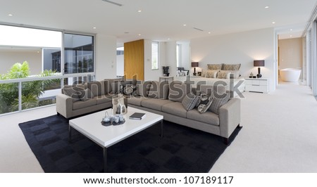 Luxurious bedroom with living area in Australian mansion - stock photo