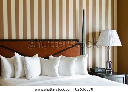 luxurious but generic hotel room decor - stock photo