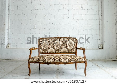 Luxurious classical vintage sofa on white background - stock photo