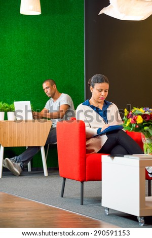 Luxurious corporate lounge, with two people working quietly and comfortably - stock photo