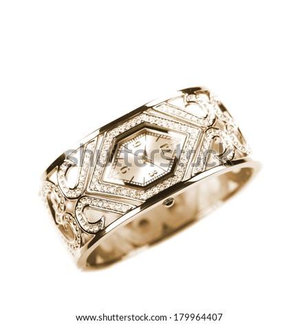 luxurious female golden wristwatch closeup shot - stock photo