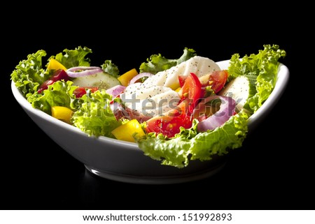 Luxurious fresh colorful vegetable salad isolated on black background. Healthy eating. - stock photo