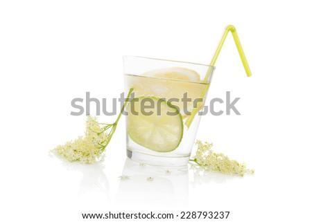 Luxurious fresh elderberry homemade lemonade in glass with straw with fresh elderberry flower isolated on white background. Fresh summer drink. - stock photo