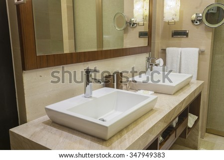 Luxurious hotel bathroom with two vanity basins - stock photo