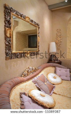 luxurious interior drawing-room with sofa and pillow - stock photo