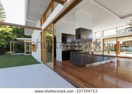 Luxurious kitchen and living room in new mansion - stock photo
