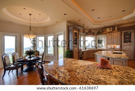 Luxurious kitchen in new home - stock photo