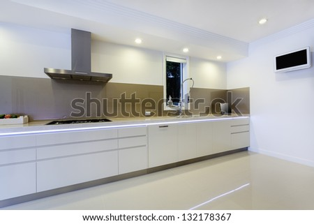 Luxurious kitchen with built in bench lights - stock photo