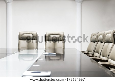 luxurious meeting room in a big corporation is sepia style - stock photo