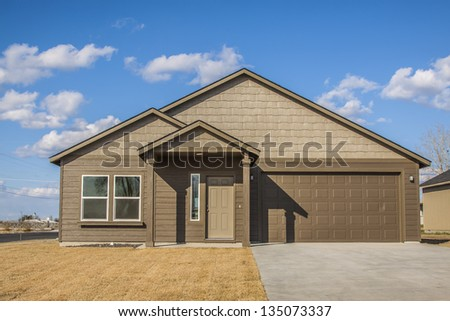Luxurious modern American new house with blue sky - stock photo