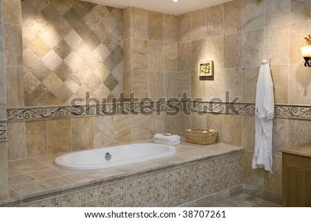 Luxurious modern bathroom with bathtub and hanging bathrobe - stock photo