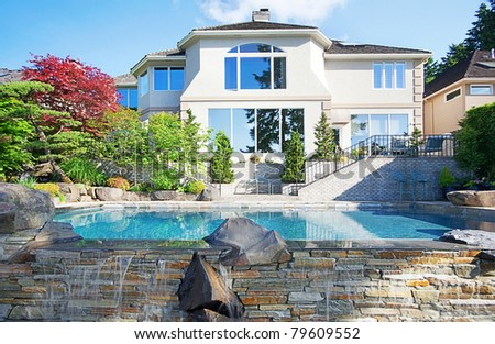 Luxurious New Home with Backyard Infinity Pool - stock photo