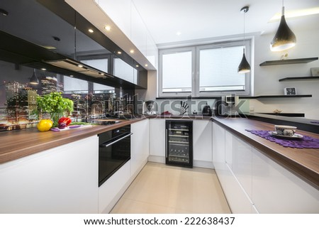 Luxurious new kitchen with modern appliances - stock photo