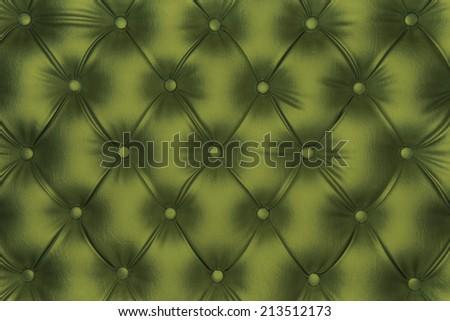 Luxurious olive green-tone leather texture furniture with buttons - stock photo