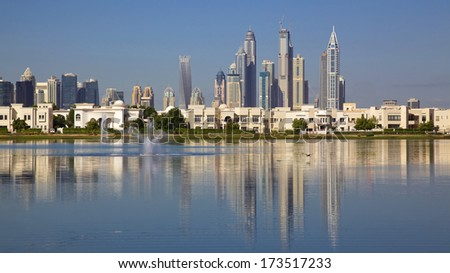 Luxurious residential villas in Dubai, with tower blocks in the background. - stock photo