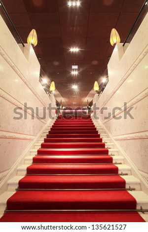 luxurious staircase with red carpet - stock photo