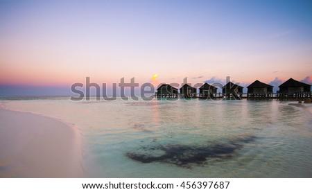 Luxurious Villas on the turquoise water in Maldives, Kuredu - stock photo