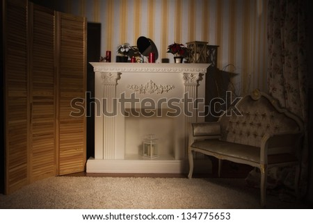 Luxurious vintage interior with fireplace in the aristocratic style - stock photo