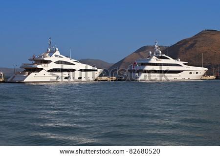 Luxurious yachts anchored at Argostoli of Kefalonia island in Greece - stock photo