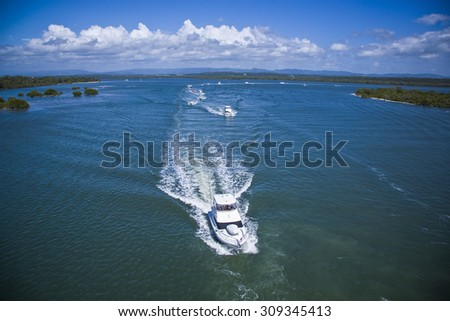 Luxurious yachts sailing in the sea with many islands on a beautiful day - stock photo