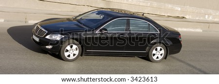 """luxury and power car: man driving and talking on the phone Part of my """"luxury cars"""" series - stock photo"""