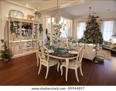 luxury apartment decorated for christmas with table set for dinner - stock photo