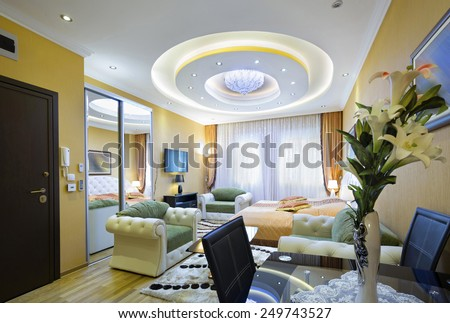 Luxury apartment interior with modern ceiling lights  - stock photo
