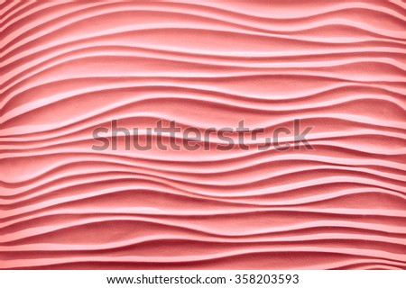 Luxury art template in form of sandy seaside shore dune bend shape in plain artistic style with soft shadow. Pastel rose color artistic gesso emboss build fond design. Closeup view with space for text - stock photo