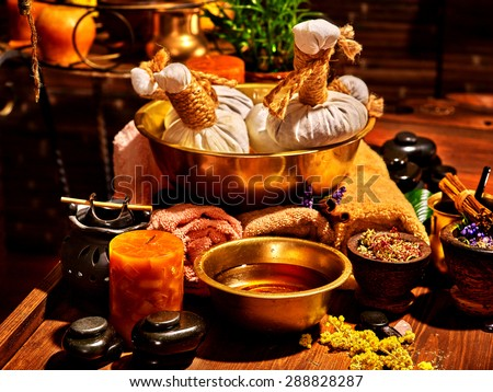 Luxury ayurvedic spa massage still life. Oil and stone. - stock photo