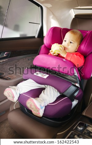 Luxury baby car seat for safety with happy kid - stock photo