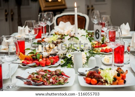 Luxury banquet table setting at restaurant - stock photo