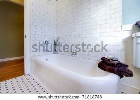 Luxury bathroom in an old house in Tacoma, WA Antique iron cast tub has been refinished. - stock photo