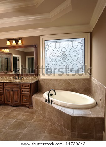 Luxury Bathroom with tub and Stained Glass - stock photo