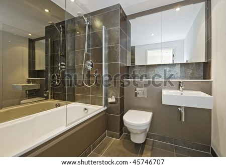 luxury bathroom with white suite and dark brown ceramic tiles - stock photo