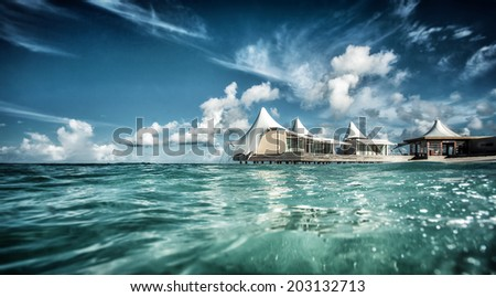 Luxury beach resort, beautiful little houses on the water, tropical vacation, spending summer holidays on Maldives, travel and tourism concept  - stock photo
