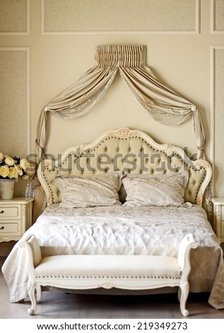 Luxury bed in romantic style bedroom - stock photo