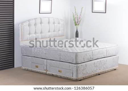 Luxury bedding mattress in a set up bedroom atmosphere - stock photo