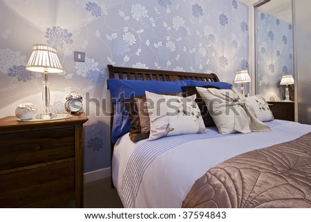 luxury bedroom detail with flower pattern wallpaper - stock photo