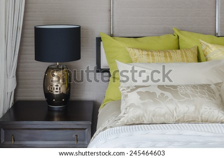 Luxury bedroom with black lamp on table at home - stock photo