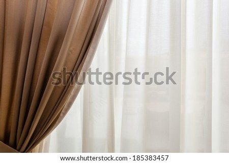 luxury beige drapes in a big luminous hall - stock photo