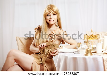 Luxury blonde in interior New Year. Young beautiful trendy girl celebrating Christmas. The friendly woman - stock photo