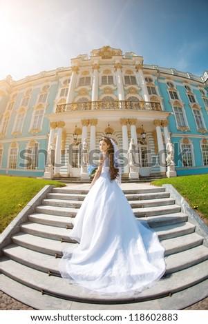 Luxury bride near palace - stock photo