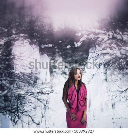 Luxury brunet fashion woman in winter garden - stock photo