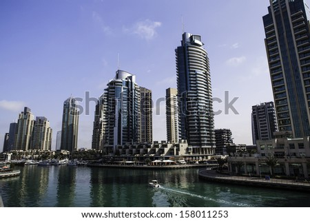luxury building skyscraper and yacht sea port - stock photo